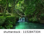river cascade in a green forest ... | Shutterstock . vector #1152847334