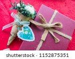 white  flower with gift box  on ... | Shutterstock . vector #1152875351
