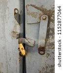 old padlock on the gate. on... | Shutterstock . vector #1152877064