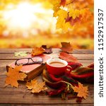 autumn leaves  book and cup of... | Shutterstock . vector #1152917537