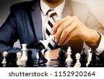 businessman playing chess board ... | Shutterstock . vector #1152920264