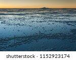 sunset in the salar de uyuni ... | Shutterstock . vector #1152923174