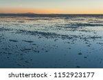 sunset in the salar de uyuni ... | Shutterstock . vector #1152923177