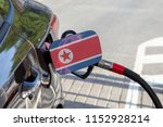 flag of korea north on the car... | Shutterstock . vector #1152928214