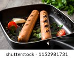 grilled sausages in iron pan on ... | Shutterstock . vector #1152981731