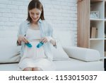 pregnant young woman holds... | Shutterstock . vector #1153015037