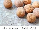 walnuts on stony background | Shutterstock . vector #1153045934