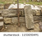 Small photo of Natural stone wall, sandstone texture. Using of historical soft sand stones prepare for rebuilding of old house.