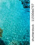Blue turquoise ripple water in mediterrean bay. The crystal clear sea and sun. Swimming summer time - stock photo