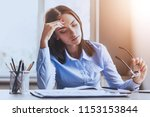 pensive business lady leaning... | Shutterstock . vector #1153153844