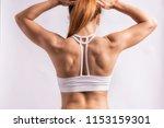 muscular femala back   Shutterstock . vector #1153159301