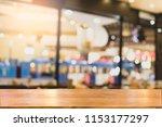 wooden desk at blurred cafe... | Shutterstock . vector #1153177297