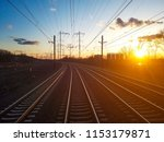 empty train tracks reflecting... | Shutterstock . vector #1153179871