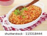 a serving bowl full of spanish...   Shutterstock . vector #115318444