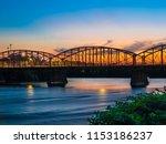 Ouellette Bridge (Aiken street bridge) over Merrimack river at sunset in Lowell, Massachusetts