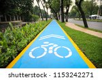 sky blue bicycle lane on... | Shutterstock . vector #1153242271