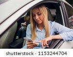 happy blonde woman showing... | Shutterstock . vector #1153244704