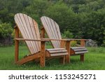 two wooden adirondack chairs ... | Shutterstock . vector #1153245271