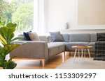 wooden table next to grey...   Shutterstock . vector #1153309297