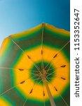 beach umbrella shot from below... | Shutterstock . vector #1153352647