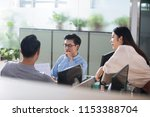 business people discussing in... | Shutterstock . vector #1153388704