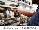 young male barista preparing... | Shutterstock . vector #1153408564