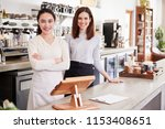 two female coffee shop owners... | Shutterstock . vector #1153408651