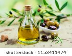 olive oil in a glass bottle | Shutterstock . vector #1153411474