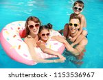 happy family in swimming pool... | Shutterstock . vector #1153536967
