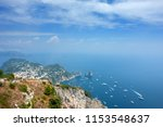 view of faraglioni cliffs and... | Shutterstock . vector #1153548637