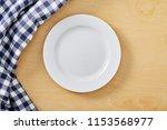 cell napkin om wooden table...   Shutterstock . vector #1153568977