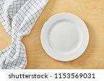 cell napkin om wooden table...   Shutterstock . vector #1153569031