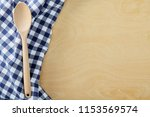 wood spoon with blue cell...   Shutterstock . vector #1153569574