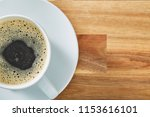 cup of coffee on wooden table...   Shutterstock . vector #1153616101