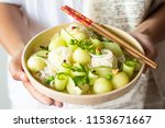 warm salad with rice noodles ... | Shutterstock . vector #1153671667