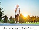 the elderly man running on the... | Shutterstock . vector #1153713451
