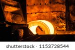 roll of hot metal on the... | Shutterstock . vector #1153728544
