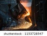 pouring of liquid metal in open ... | Shutterstock . vector #1153728547