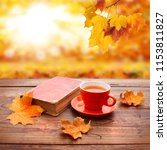 autumn leaves  book and cup of... | Shutterstock . vector #1153811827