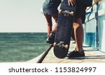 young skater boy holding old... | Shutterstock . vector #1153824997