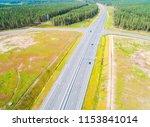 aerial view of highway in city. ... | Shutterstock . vector #1153841014