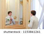 groom convalescent tie before... | Shutterstock . vector #1153861261