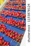 many red cherries on conveyor... | Shutterstock . vector #1153878124