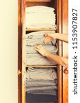 female hands holding stack...   Shutterstock . vector #1153907827
