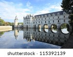 Chateau de Chenonceau and reflection on the river - stock photo