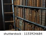 book shelves in long room of... | Shutterstock . vector #1153924684