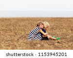 sister embracing her brother... | Shutterstock . vector #1153945201