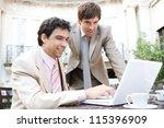 two businessmen having a... | Shutterstock . vector #115396909