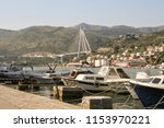 boats on the quay of dubrovnik... | Shutterstock . vector #1153970221