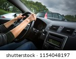 female driver's hands driving a ... | Shutterstock . vector #1154048197